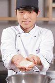 Постер, плакат: Sushi chef cooks rice