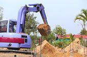 picture of backhoe  - backhoe tractor works on a construction site - JPG