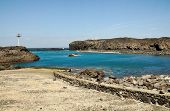 stock photo of arid  - The bay of Salinas in the town of Sao Jorge on the island of Fogo Part of Republic of Cabo Verde with its dry arid aroma during a sunny afternoon - JPG