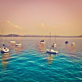 stock photo of italian alps  - Yachts on the Italian Lake Lago Maggiore at Sunset Instagram Effect - JPG