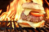image of bbq party  - Homemade BBQ Beef Burger On The Hot Flaming Grill. Good Snack For Outdoors Summer Party Or Picnic