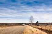 foto of barn house  - The gravel road leads through the group of little barn houses - JPG