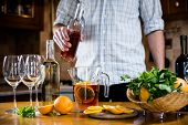 pic of sangria  - Man pouring red wine into a carafe - JPG