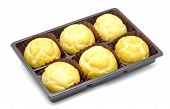 stock photo of cream puff  - Sweet cream puffs made of Puff pastry ready to be filled with fresh custard creams - JPG