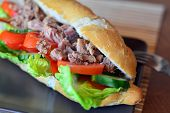 stock photo of baguette  - Healthy Tuna Baguette With Lettuce,Tomato,Cucumber On The Brown Plate On The Table ** Note: Shallow depth of field - JPG