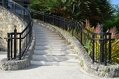 foto of stairway  - Coral stone stairway with Iron railings with palm tree images on the top - JPG