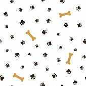 image of footprint  - Dog theme seamless pattern with heart shaped animal paw footprints and bones - JPG