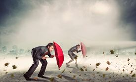 stock photo of hurricane wind  - Businessman and businesswoman in storm - JPG