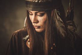 stock photo of indian chief  - Woman with traditional indian headdress and face paint  - JPG