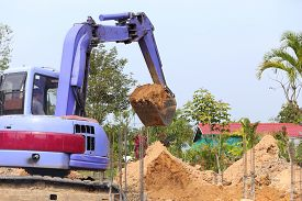 stock photo of backhoe  - backhoe tractor works on a construction site - JPG