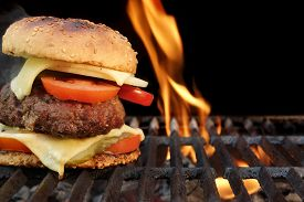 pic of grating  - Homemade BBQ Beef Burger On The Hot Flaming Grill. Good Snack For Outdoors Summer Party Or Picnic ** Note: Shallow depth of field - JPG