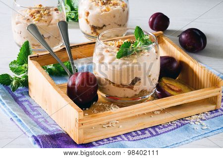 Dessert With Whipped Cream, Roasted Nuts Oatmeal, Prunes And Walnuts In Glass Glasses