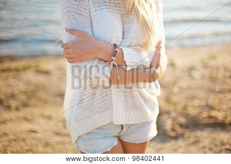 Close-up of girl in white pullover and denim shorts