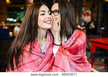 Two young and beautiful girls share secrets