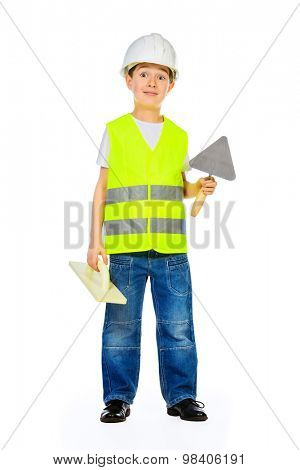 A boy in a costume of a builder posing with different tools. Isolated over white.