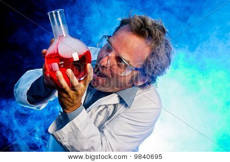 Crazy scienctist handling explosive concoction