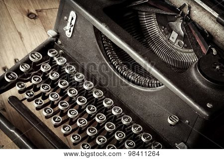Vintage typewriter, with closeup on keys.  Full of dust and dirt.  Grunge effects.