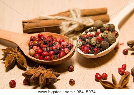 Spoons With A Mixture Of Grains Of Pepper, Cinnamon And Star Anise