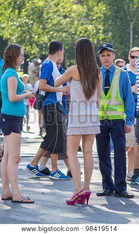 Donetsk, Ukraine - June 11, 2012: Young Officer Was Talking To A Woman During The European Champions