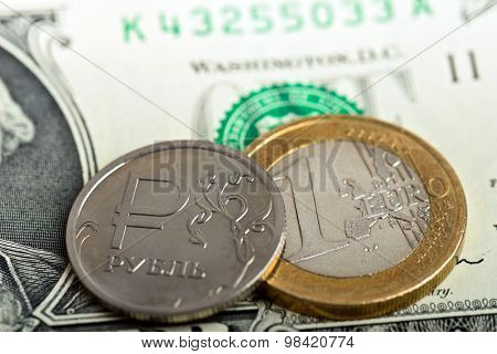 coin one ruble and euro against US dollar background