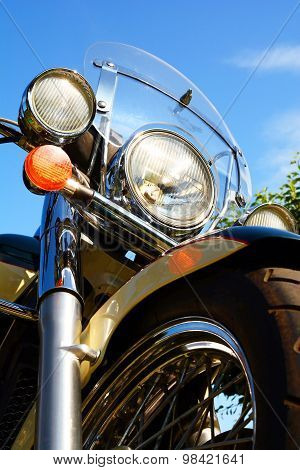 Motorcycle Detail Closeup Front Fork And Headlight And Wheel.