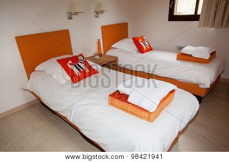 Two Beds Bedroom With Bedside Table And Lamp, Orange And White Color