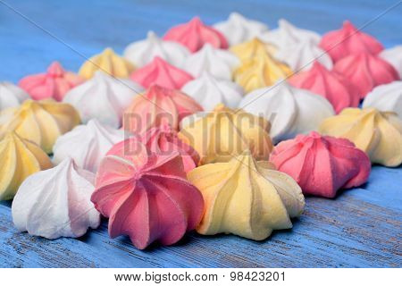 French Vanilla Meringue Cookies On Blue Background.