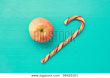 Fresh apple and candy cane
