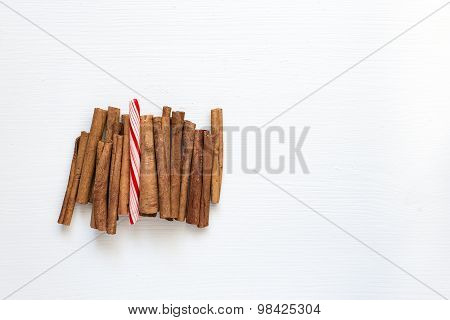 Cinnamon sticks and candy, top view