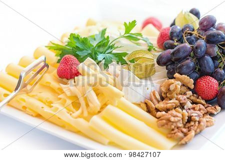 Cheese Plate with Grapes, Nuts and fruits