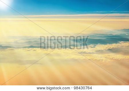View From A Plane To Sunset On The Sky