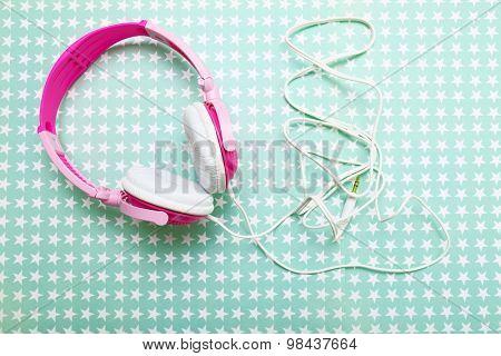 Headphones on stars background