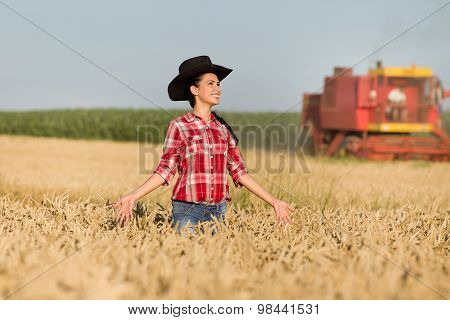 Girl With Cowboy Hat In Wheat Field