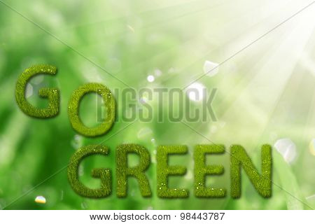 Go green sign on natural background