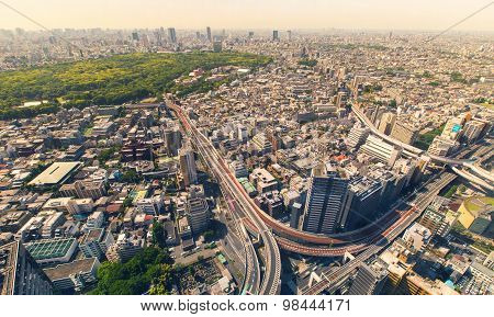Aerial View Of A Massive Highway Intersection During Morning Rush Hour In Shinjuku, Tokyo