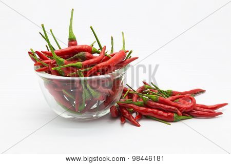 Fresh red hot chilli in a glass cup