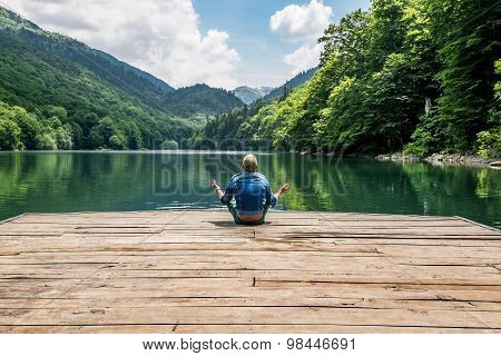 The Man Meditating In Lotus Position On Biogradsko Lake In The National Park Biogradska Gora