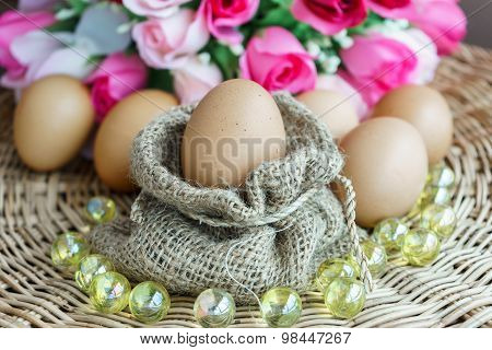 Heap Of Chicken Eggs With Rose In Background