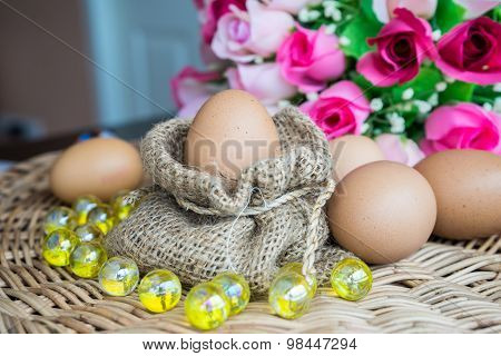 Chicken Eggs In Sackcloth And Rose Lay Down On Basketwork