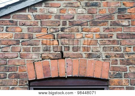 step cracking to brickwork above a window