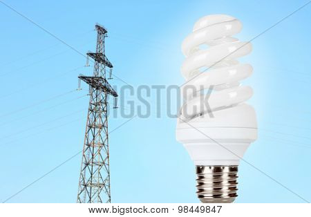 Light bulb on high voltage line background
