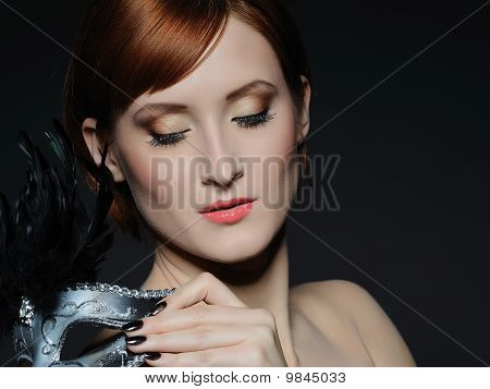Beautiful Woman With Perfect Skin And Party Make-up In Carnival Mask