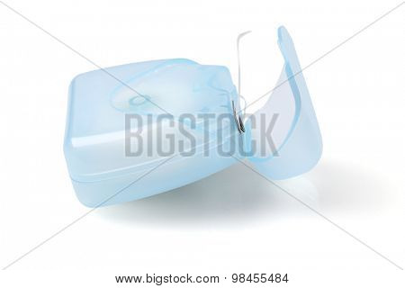 Dental Floss in Plastic Container on White Background