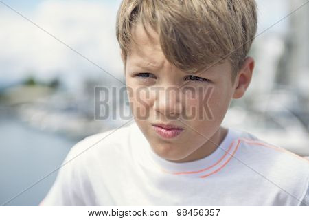 Young teen boy standing on the beach