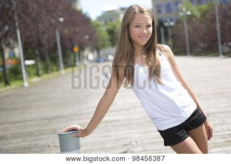 Young long-haired teen girl standing outside