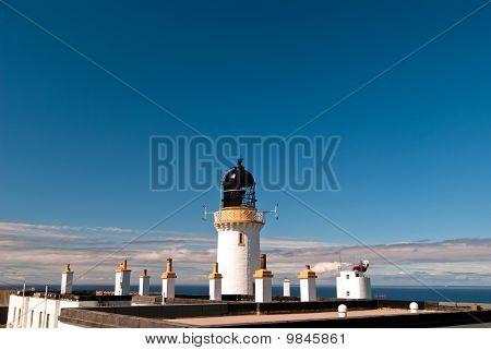 Lighthouse Against A Blue Sky V1