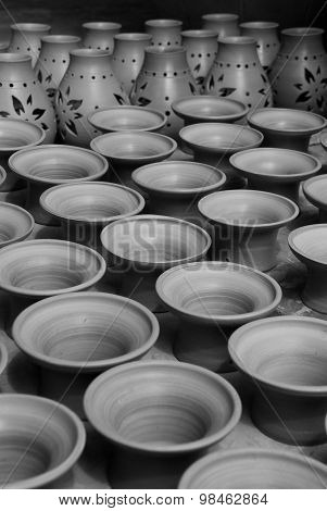 Black and white handmade terra cotta jars