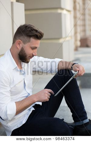 Man freelancer with tablet PC