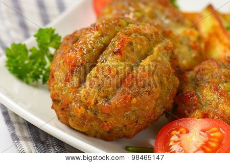detail of fried meatballs on white plate