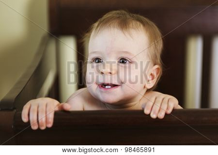 beautiful baby in a crib at home